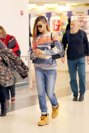 Rihanna is fresh faced as she walks through the airport terminal in Los Angeles